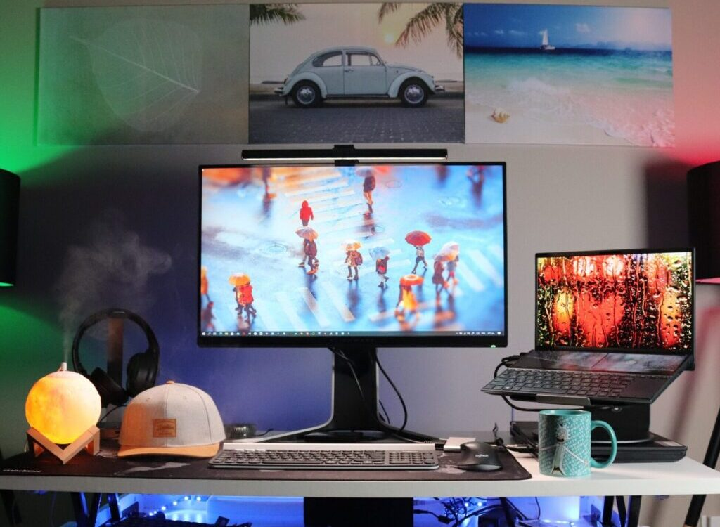 black flat screen computer monitor on white desk