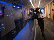 woman in black top using MacBook