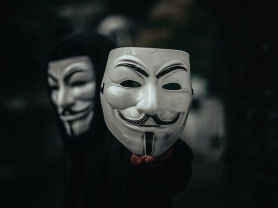 person in black and white mask