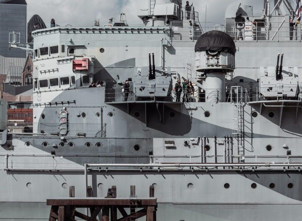 grey battleship in dock