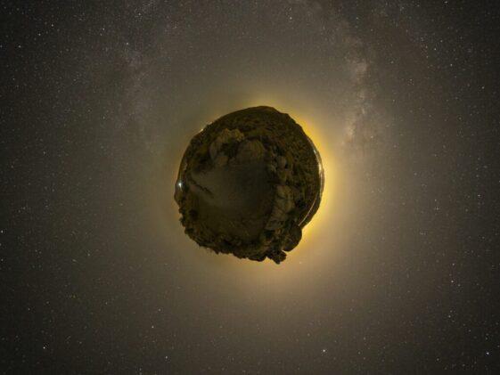 floating rock on galaxy illustration