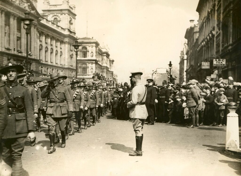 soldiers walking near people at the city photo